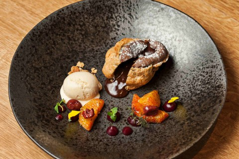Chocolate fondant with cardamom and sour cherries, blood orange, banana ice cream
