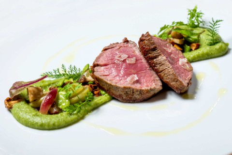 Veal fillet, potato purée with celery, mushrooms, pancetta, fava beans, grapes, chanterelle mushroom sauce