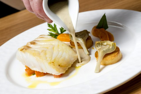 North Atlantic wild cod, carrot, artichokes, potato fondant, fennel sauce