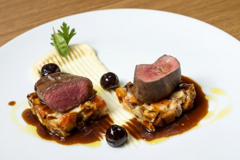 Venison fillet, roasted vegetables, celeriac purée, Amarena cherry sauce