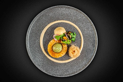 Baked celeriac, avocado crème, lime hummus, cauliflower purée with curry madras, zucchini