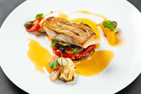 Red fish fillet, vegetable tian, artichokes, capers, blood orange reduction with aperol spritz